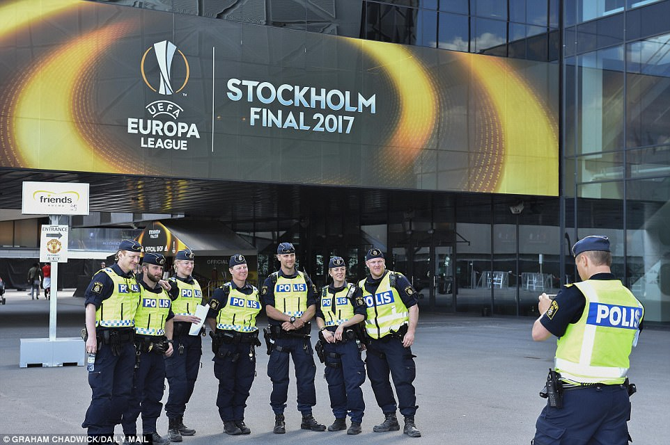 Despite a strong police presence around the stadium things looked to be relaxed, with officers posing for a picture