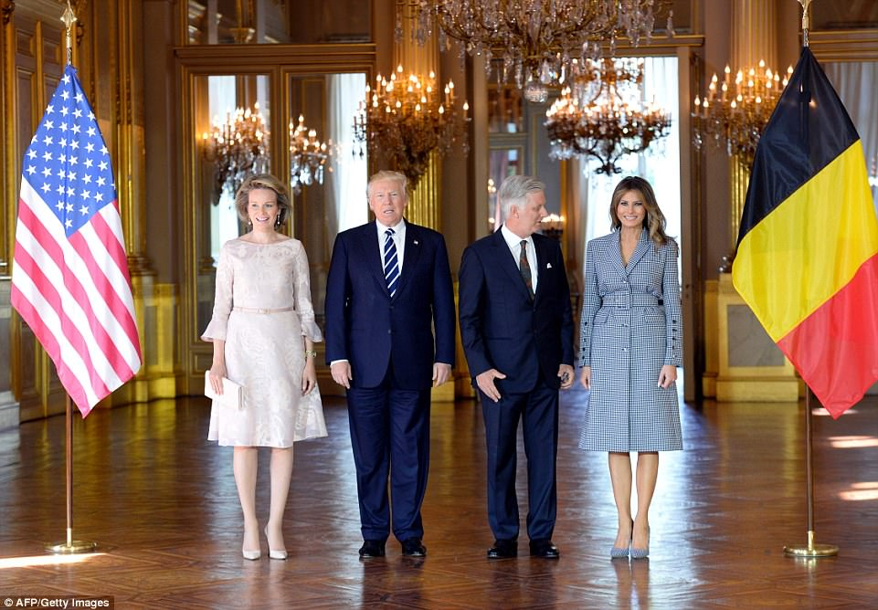 The couple headed straight to a meeting with King Philippe of Belgium (center right) and his wife Queen Mathilde (far left) at the Royal Palace of Brussels on Wednesday evening
