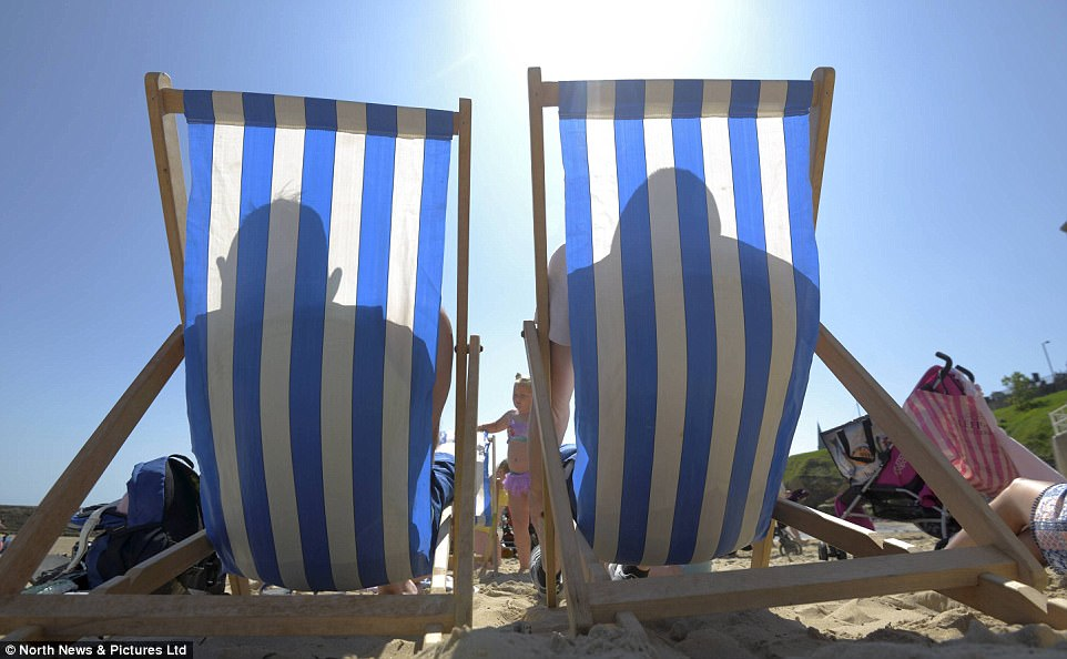 Sunseekers relax in deckchairs at Cullercoats Bay. The hot weather could create issues for hayfever sufferers, however