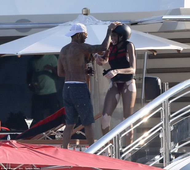 Close: Lewis and Winnie seemed inseparable on board as the F1 racer joked around with the beaming model