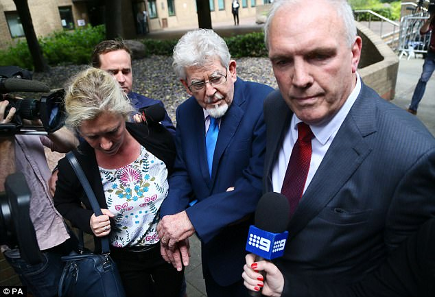 Harris, pictured today outside court, had been accused of indecently assaulting three girls