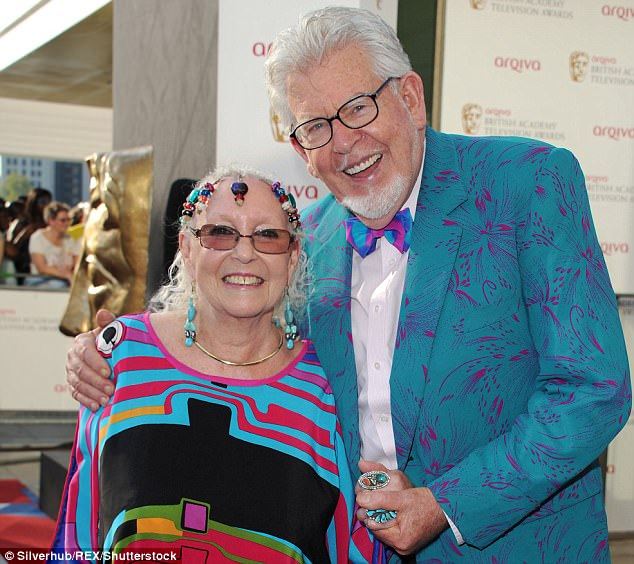 In happier times: Pictured above the disgraced former presenter Rolf Harris and his wife Alwen