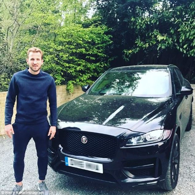 Tottenham star Harry Kane stands next to his Jaguar F Pace in a recent Instagram post
