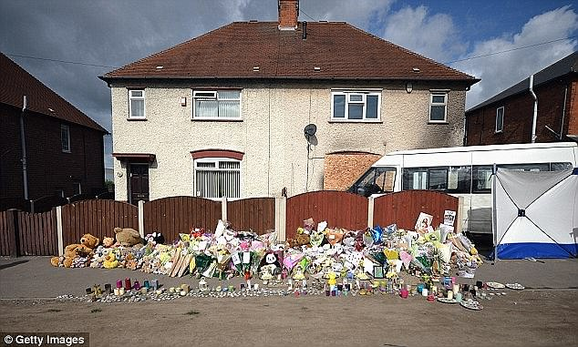 The Philpott house following the fire - hundreds of floral tributes were left for the children