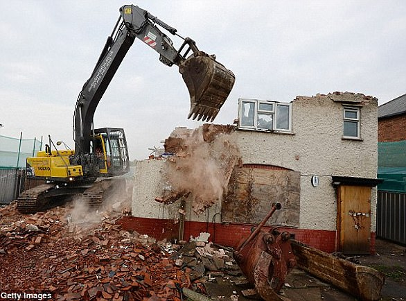 The semi-detached home was demolished following the fire which killed six children