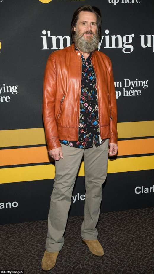 Doing her job: Jim Carrey defended Kathy Griffin's controversial Donald Trump photo Wednesday, telling ET that as a comedian, it's the star's 'job to cross the line.' Above the 55-year-old star is seen at the premiere of Showtime's I'm Dying Up Here