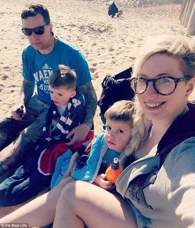 Terrifying: Siobhan Hatch, 30, pictured with boyfriend Andy and her sons, Leon, four, and Andre, two, was diagnosed with a rare condition after suffering from pins and needles