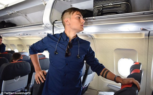 Argentina striker Paulo Dybala looks to the back of the plane before take-off on Friday