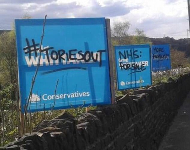 These Conservative signs were plastered with the slogans 'Tories out', 'NHS for sale' and 'more austerity'