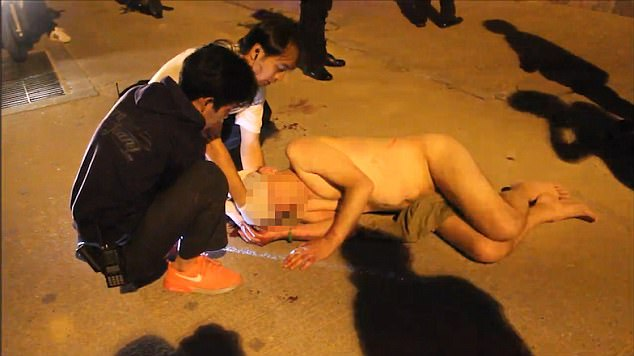 The footage shows a naked middle-aged man in his 40s lying on the ground after falling from a hotel balcony. He had been staying with prostitute Sittipong Maneekat, 35
