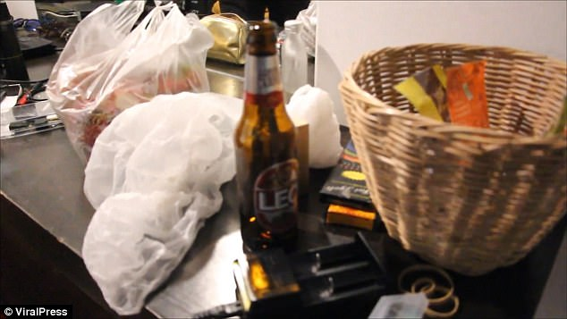 Alcohol and bags of food were seen in the room as police searched it for evidence this morning
