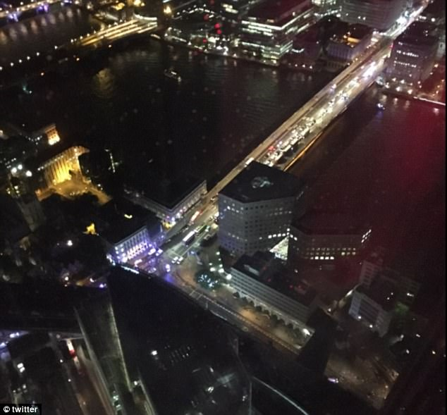 The bridge was seen to be on lockdown. London Bridge and the area around it has been closed due to a 'major police incident', TFL said