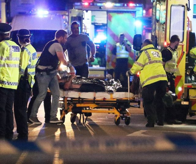 A wounded victim was wheeled out on stretcher by London Bridge as shocked people cried and shouted around them. At least 48 injured people were rushed to five hospitals around London after the terror attack