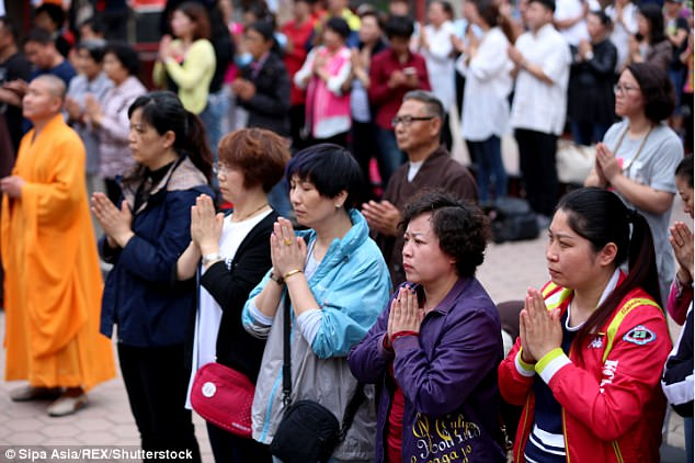 Parents of examinees pray for good luck for their children in Shenyang, northeast China