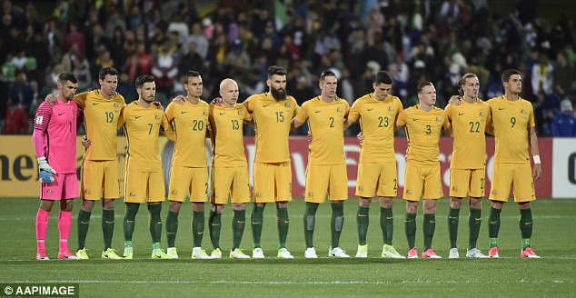 The Australian football team lined up with their arms linked to pay their respects to those caught up in the recent attack on London