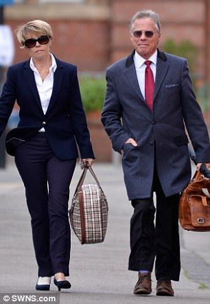BBC radio stars Tony and Julie Wadsworth arrive at Warwick Crown Court with their belongings on the the final day of their trial