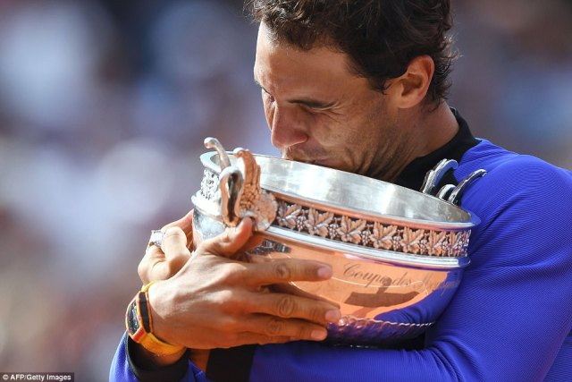 Spanish champion Rafael Nadal clutches the Coupe Des Mousquetaires in his grasp, the only man ever to have won it 10 times