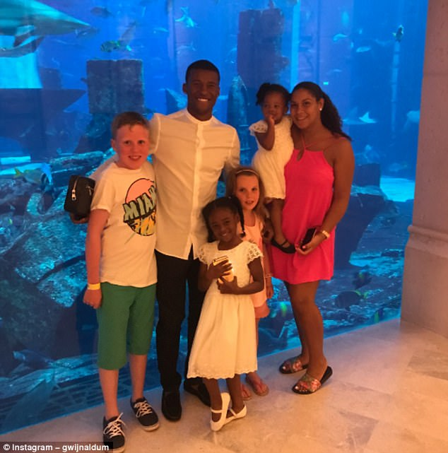 Liverpool'sGeorginio Wijnaldum was on holiday at an aquarium in Dubai with his family