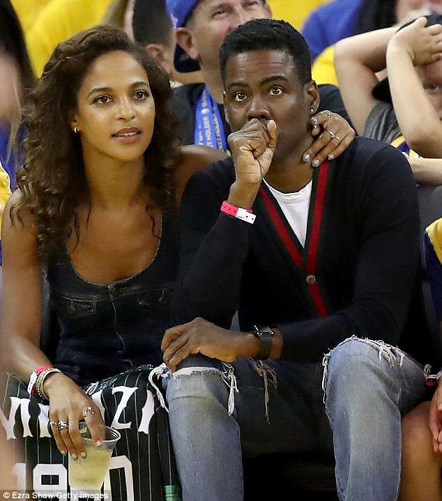 PDA: The half-Igbo Nigerian, half-Navajo Indian beauty kept an arm around the SNL veteran as they watched the Golden State Warriors beat the Cleveland Cavaliers (129-120) during game five of the NBA Finals