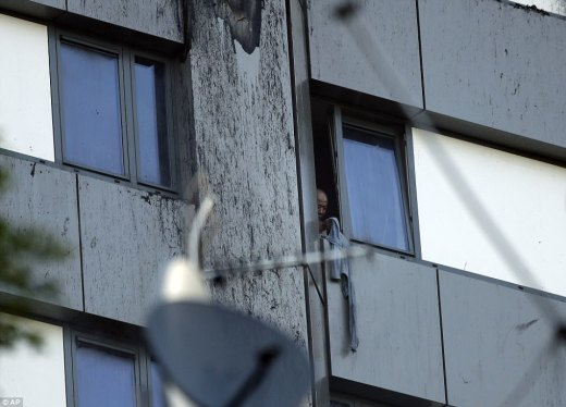 At least one resident is still stuck inside the block on the 11th floor, with firefighters still desperately trying to reach him