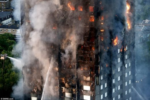 A woman with six children who was attempting to escape from the 21st floor of the London tower block fire this morning got to the bottom to discover two of them were missing, it has been claimed