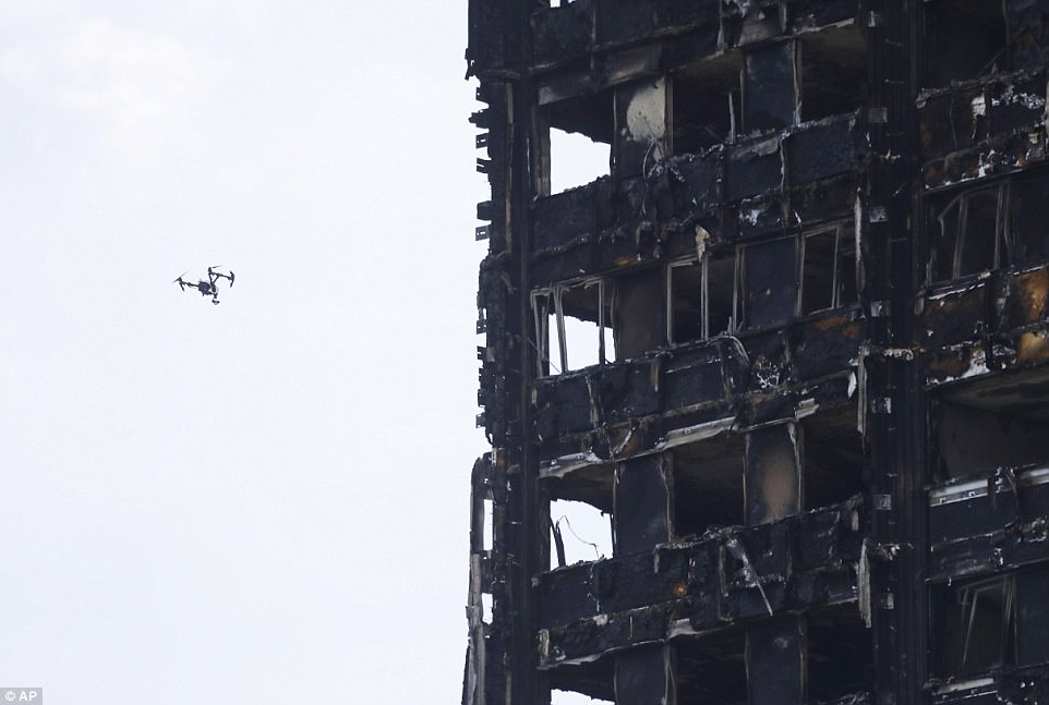 A drone inspects the top floors of the wrecked tower block, where residents on the highest storeys are all feared dead