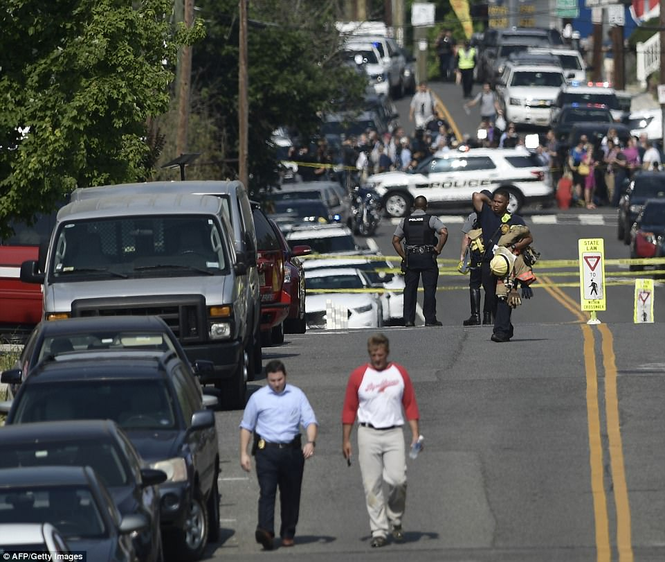 Sen. Jeff Flake is pictured walking away from the chaotic scene outside the stadium park