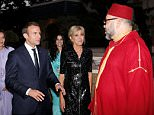 Mohamed VI sat in between Macron and Brigitte during the lavish meal at the Moroccan King's personal home, the King Palace, in Rabat