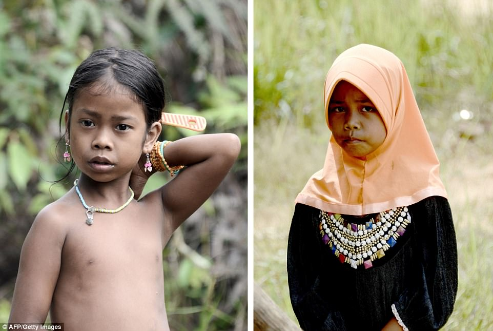 Pictured left: A young girl from the tribe who has not converted to Islam. Right: Another girl of a similar age wearing a hijab after becoming a Muslim. An elder in the tribe said the government might now begin listening to their problems after their conversion