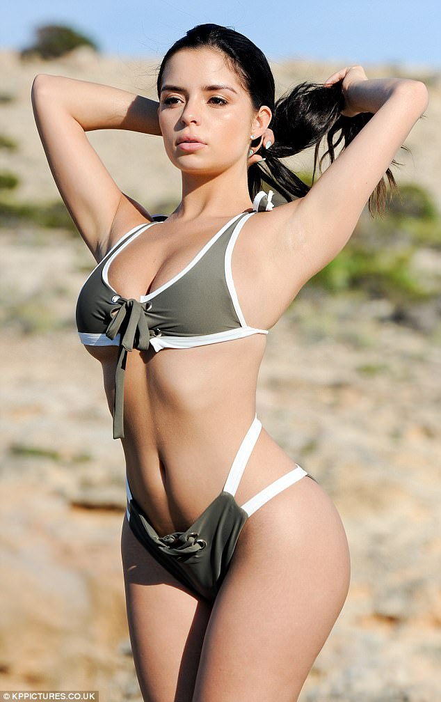 Careful: Demi playfully toyed with the front of the bikini top, surely checking that it was not about to take onlookers by surprise and burst open in a moment of stubbornness
