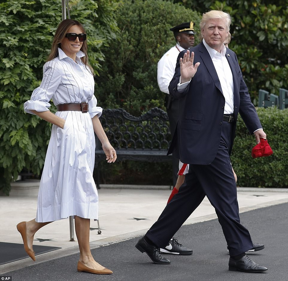 Trump waved to photographers as he departed the White House in a navy suit, while Melania donned a belted  shirt dress