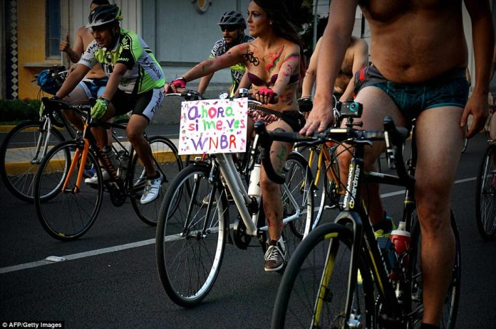Some were covered in full-body paint displaying pro-cyclist messages; various intimate piercings and tattoos were also on show, while others chose to protect their modesty