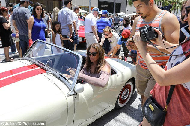 Sloughed off?: Yetnone of the Kardashians - Kourtney, Kim, Khloe and Rob - were seen at the car show with Caitlyn, though she'd helped raise them as their stepfather for years