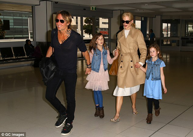 Happy family! With Keith and daughtersSunday Rose and Faith Margaret by her side, Nicole's new life seems picture perfect