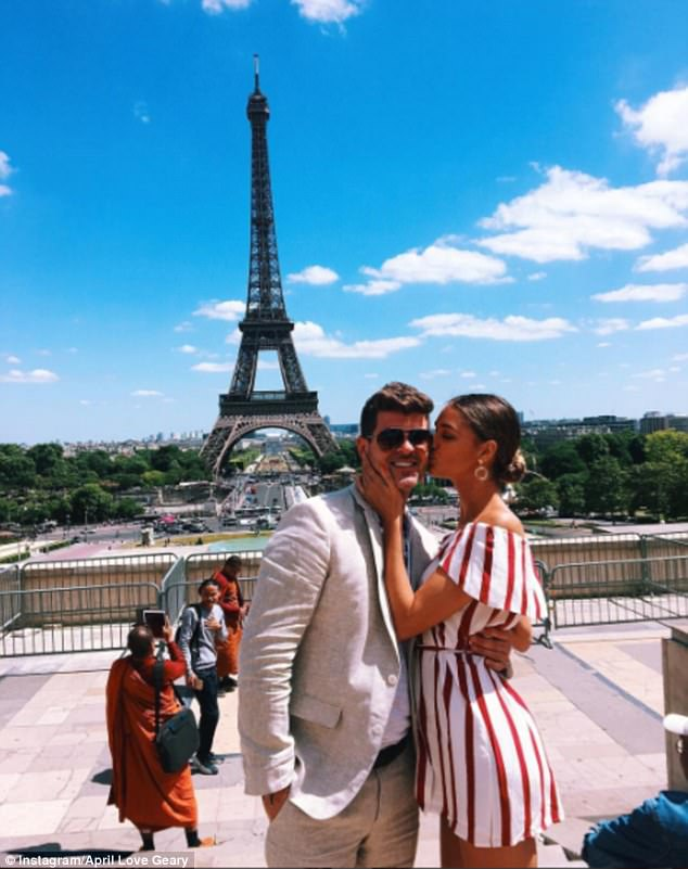 Flaunting it: April has been in Europe with Robin. The two were seen getting close in Paris by the Eiffel Tower in a shot shared to Instagram