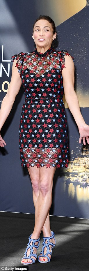 Patton looked gorgeous in her sheer black mini dress that had red and light blue stars on it