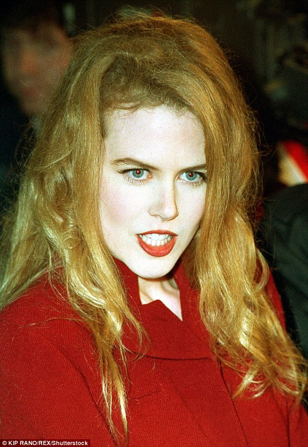 Red hot! The talented beauty showcased a vampy look in the early 2000s