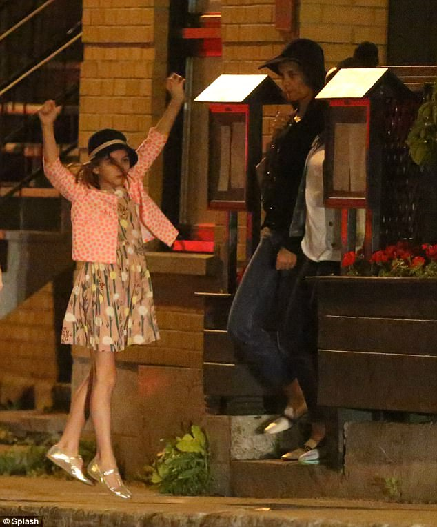 Jump for joy! Suri was clearly having a blast during her night out with mom