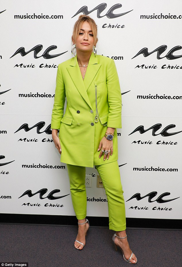 Relaxed: Rita looked confident in her lime green ensemble, which she paired with a chunky watch and statement rings