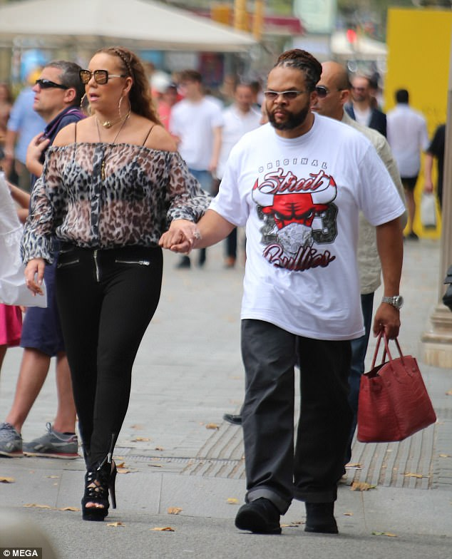 Here she comes!Dressed to impress, Mariah Carey made the most of her ample curves as she flashed her black bra through a sheer leopard print blouse during a shopping trip in Barcelona