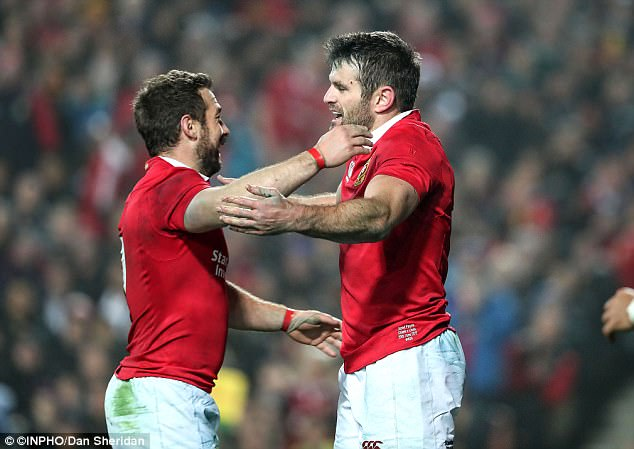 Jared Payne celebrates scoring the Lions' fourth try against the Chiefs with Greig Laidlaw