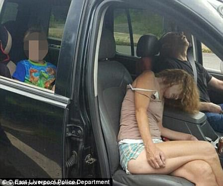 Ohio police sparked controversy by posting a photo of two parents passed out from an opioid overdose while driving with their child in the back seat
