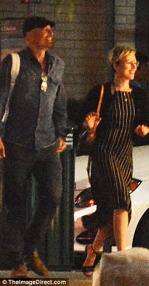 On the go: The couple appeared relaxed and in good spirits