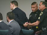 Guilty:Washington County Sheriff's Officers place handcuffs on Matthew Slocum, 29, after he was found guilty on all counts in his triple murder retrial on Tuesday
