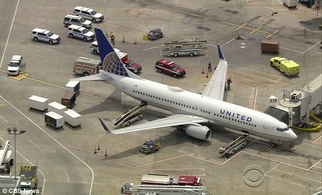 United flight 1031 came across the turbulence while cruising about 18 miles east of Cancun, Mexico. The plane pictured on the tarmac in Houston on Tuesday above