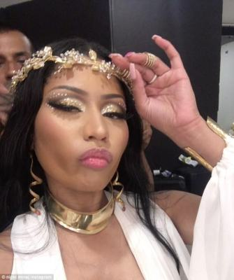 Rap royalty:She even sported a gold wreath tiara, which crowned her waist-long raven tresses