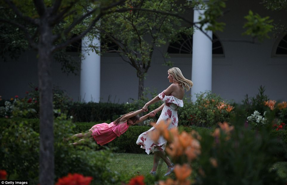 Ivanka Trump is seen in the Rose Garden of the White House swinging her daughter, Arabella