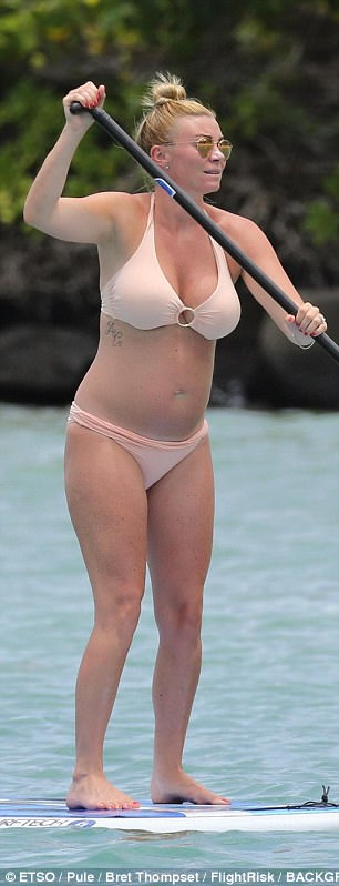Pregnant Billi Mucklow shows off growing bump in tiny bikini as she enjoys a paddleboard session