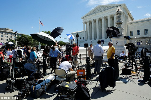 The media circus that usually accompanies a Supreme Court decision day was evident this morning in Washington outside the high court