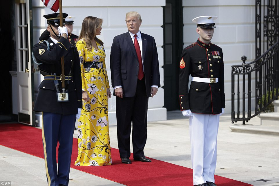 The mother-of-one stunned in the floor-length dress that retails for $2,160 as she walked alongside the president before stepping out to greet Modi, who is visiting the US for his first face-to-face meeting with the new first family